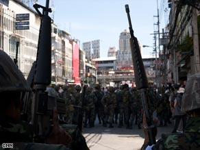 Thai soldiers secure an area early Monday in Bangkok after dispersing protesters.