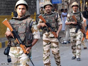 Soldiers patrol in Mumbai on the eve of the trial of a key suspect in last year's attacks in the Indian city.