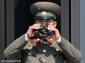 A North Korean soldier looks into South Korea from the demilitarized zone on April 9.