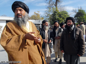 Taliban representatives leave talks in Peshawar in February after reaching a deal on Sharia law in Swat.