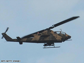 A Pakistan army gunship flies over the troubled Dir region on Monday.
