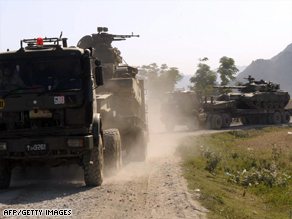 Pakistani army trucks move military equipment into the troubled Buner district Thursday.