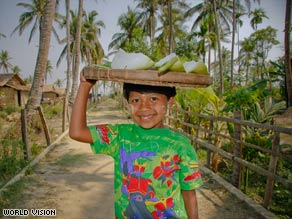 Nway, then 7, surveys her village last year after losing her parents to a cyclone.