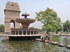School children swim in a pond to beat the heat in front of India Gate in New Delhi on April 28.