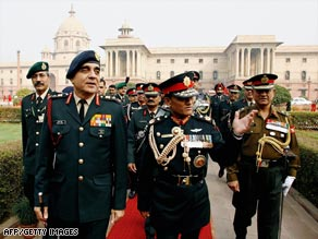 General Rookmangud Katawal gestures after inspecting a guard of honor in New Delhi on December 12, 2007.