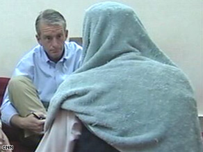 CNN's Nic Robertson, left, talks to Taliban spokesman Zabiullah Mujahid at an undisclosed location.
