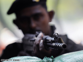 A Sri Lankan soldier guards a military checkpoint last week in the capital of Colombo.