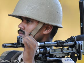 An Indian soldier on guard outside the trial of Mohammed Ajmal Kasab.