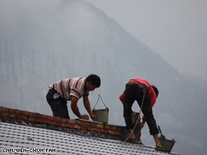 Villagers rebuild their homes in Yaojin, which was flattened in the Sichuan quake.