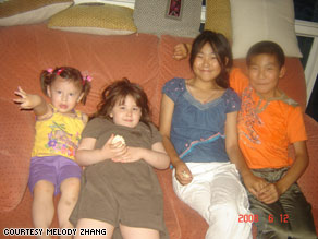 Ren Yan, bottom right, and Ren Qiang, above her, spend Chinese New Year with their foster family.