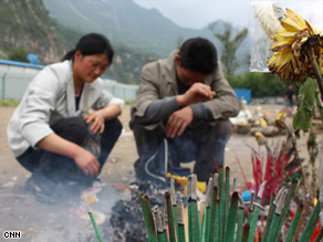 At Beichuan school, parents and relatives give offerings for their dead child.