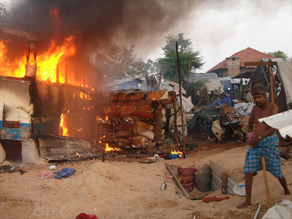A fire burns Sunday after government shelling, according to a humanitarian group in the region.