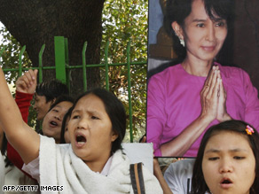 Pro-democracy supporters hold a portrait of Aung San Suu Kyi in New Delhi, India, last November.