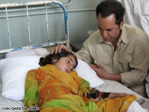 CNN's Reza Sayah with Shaista, who lost most of her family in an explosion as they fled fighting.