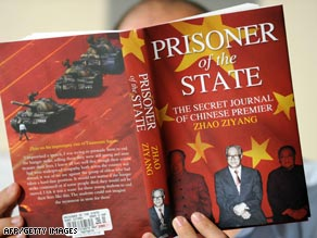 Bao Tong, a former top aide to Zhao Ziyang and father of the book's co-editor, holds up a photo of Zhao in April.