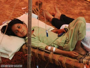 A Pakistani girl displaced by the military's offensive against the Taliban rests at a camp Saturday north of the capital.