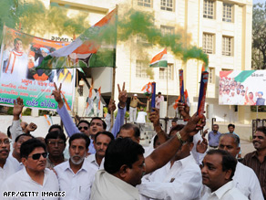 Gujarat Pradesh Congress Committee members celebrate the inauguration of Indian PM Manmohan Singh Friday.