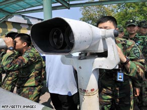 South Korean soldiers use binoculars to look at North Korea on Wednesday in Paju, South Korea.