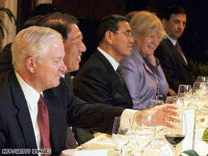 Defense Secretary Robert Gates, left, meets with other world leaders at a conference Saturday in Singapore.