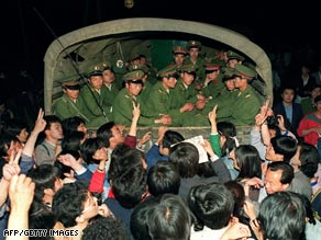 Pro-democracy demonstrators stop a truck with soldiers on its way to Tiananmen Square on 20 May, 1989.