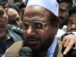 Pakistani police escort Hafiz Saeed outside court after a hearing in Lahore in May.