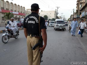 A Pakistani police stands guard at a checkpoint in Peshawar, Pakistan on June 8.
