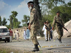 Government troops patrol in northwestern Pakistan on Friday.