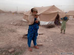 Displaced Pakistanis battle severe winds and dust at Jalozai refugee camp near Peshawar.