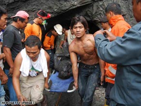 Rescuers recover a victim at the mine tunnel in West Sumatra, Indonesia, on Tuesday.