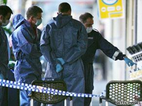 Police investigate the scene where Des Tuppence Moran was killed in Melbourne in June 2009.