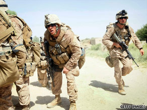 U.S. Marines, under fire from a building, move to take it Saturday in Helmand province, Afghanistan.