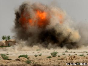 An IED is exploded by U.S. Marines near the remote village of Baqwa, Afghanistan, in March.