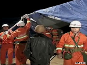 Rescue workers attend to the scene of the earthquake which hit southwest China on Thursday.