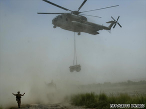 A U.S. helicopter delivers supplies for a convoy in Afghanistan's Helmand Province on Saturday.