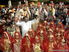 Young Indian men and women are paraded before a mass wedding in 2006 in the village of Funda.