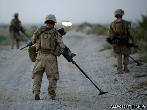 U.S. Marines sweep for bombs in  Afghanistan this week.
