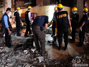 A body is removed following the blasts at the Ritz-Carlton and the nearby J.W. Marriott hotels in Jakarta on Friday.