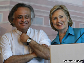 Indian Environment Minister Jairam Ramesh stands with Secretary of State Hillary Clinton on Sunday in Gurgaon.