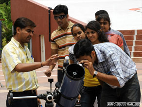 "People test the ""sky watching telescope"" at the Gujarat Council of Science City in India."