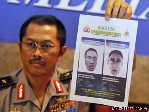 Indonesian police spokesman Nanan Sukarna shows a sketch of the suicide bombers in Jakarta on Wednesday.