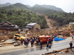 Rescue workers remove debris to search for survivors in Hofu city, Yamaguchi prefecture, on Wednesday.