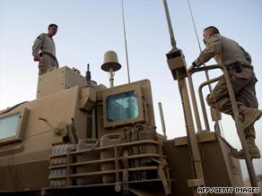 U.S. Marines prepare equipment Friday in Helmand province, Afghanistan.