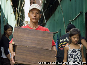 Horm Oun inspects the green sheds in Tuol Sambo before she is evicted from Borei Keila.