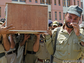 Indian police carry the coffin of a colleague murdered in an attack on Saturday.