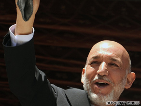 Afghan President Hamid Karzai waves at a rally in Kaihan valley on August 1.
