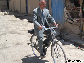 Presidential candidate Sangin Mohammed Rahmani goes out campaigning on his bicycle.