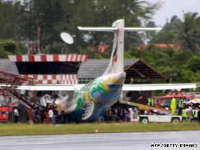 Rescue workers inspect the Bangkok Airways plane at Samui airport on Thailand's Ko Samui.