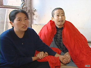 Zhou Yujin and his wife Jin Qinglian spent their savings on Zhou's medical care.