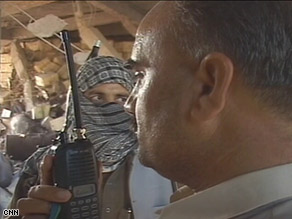 Journalist Shah is shown speaking to Taliban leader Maulana Fazlullah on a walkie-talkie.
