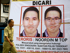 "A poster in Malang, East Java, Indonesia, has under ""dicari,"" or""wanted,"" Noordin Top."